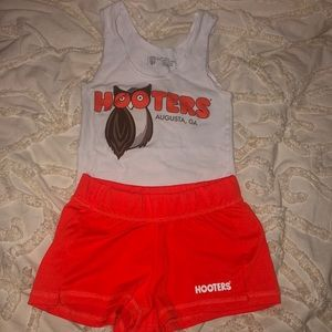 Orange and white hooters uniform